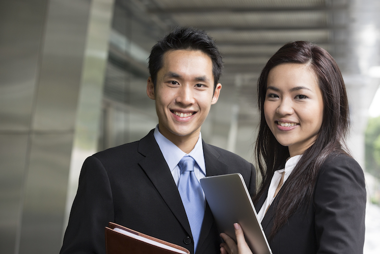 Portrait of Chinese business man and woman in a modern urban setting.